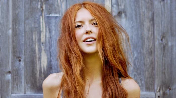 Ebba Zingmark, long hair, girl, smiling, curly hair, wooden surface, redhead
