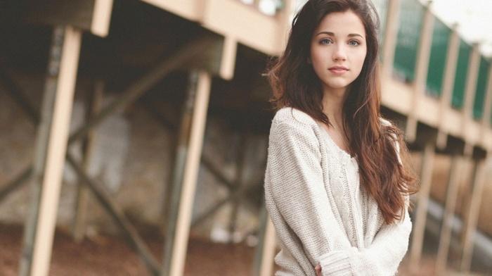 blue eyes, looking at viewer, arms crossed, brunette, sweater, long hair, emily rudd