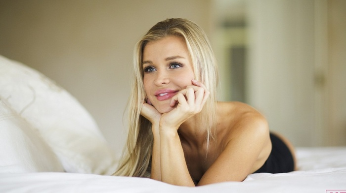 Joanna Krupa, girl, black dress, looking away, gray eyes, smiling, blonde, lying on front, in bed