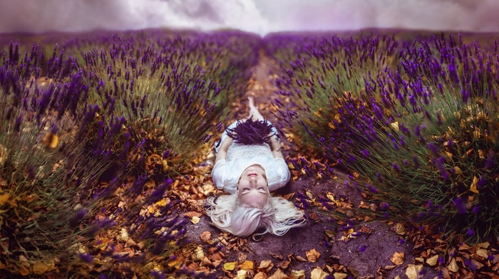 lavender, closed eyes, lying down, girl outdoors, leaves, blonde, model, purple flowers