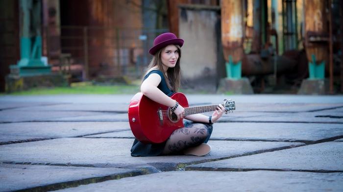 tiles, street, dress, sitting, playing, girl, model, blue eyes, long hair, guitar, brunette, stockings, girl outdoors, old building, looking at viewer