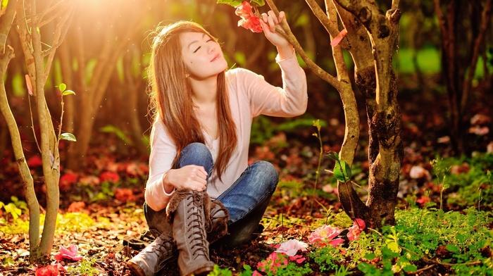 sitting, boots, trees, model, smiling, Asian, nature, jeans, forest, sunlight, long hair, flowers, closed eyes, girl outdoors, brunette, girl
