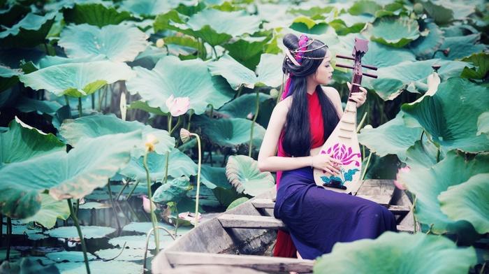 long hair, model, girl outdoors, water, girl, playing, sitting, water lilies, nature, flowers, lake, Asian, boat, dark hair, leaves, music