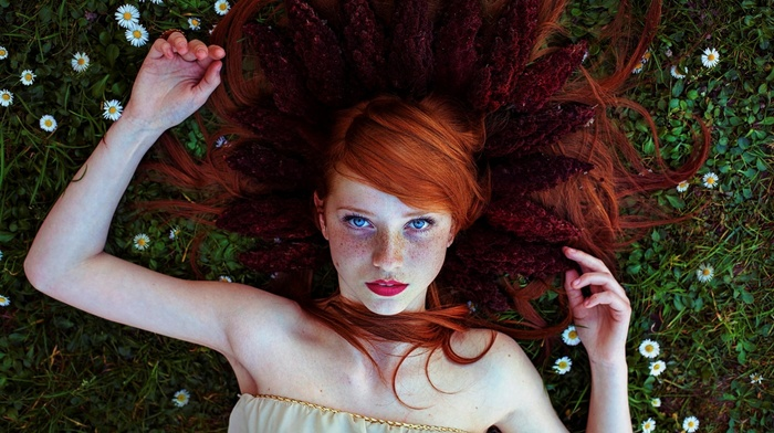 red lipstick, blue eyes, face, long hair, girl, lying on back, flowers, girl outdoors, looking at viewer, redhead, lying down, freckles, grass