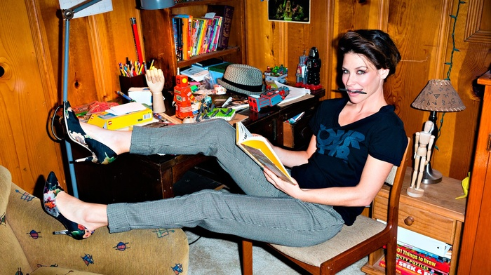 reading, pants, high heels, evangeline lilly, short hair, brunette, sitting, looking at viewer, stiletto, wooden surface, smiling, T, shirt, interiors, girl, chair, table, model