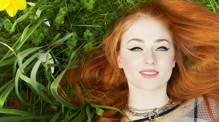 redhead, Sophie Turner, lying down, nature, yellow flowers, girl, blue eyes, face, makeup, girl outdoors, smiling, model, long hair, grass, red lipstick, open mouth