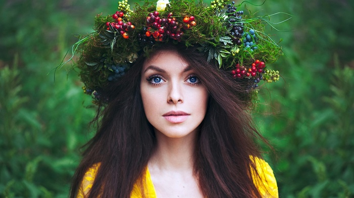 crowns, fruit, model, blue eyes, girl outdoors, brunette, looking at viewer, yellow clothing, face, long hair, nature, green, girl, berries, portrait