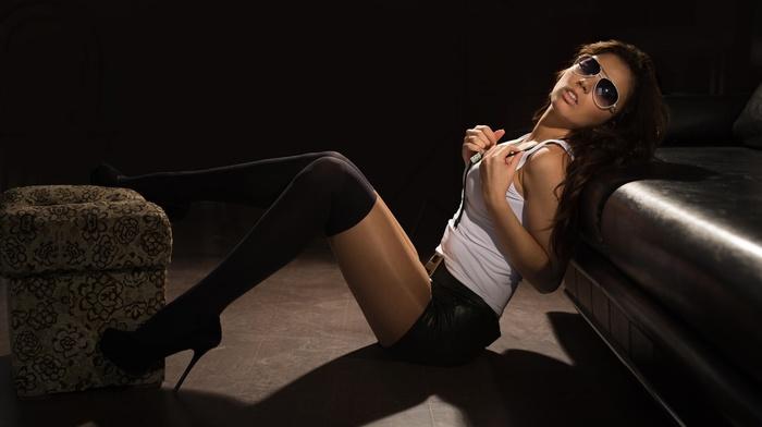 jean shorts, brunette, girl with glasses, long hair, girl, stockings, knee, highs, black stockings, couch, sitting, black heels, model, high heels