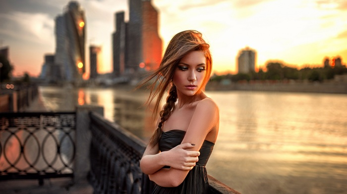 redhead, sunset, black dress, long hair, bare shoulders, looking away, fence, depth of field, looking down, open mouth, girl, girl outdoors, portrait, Georgiy Chernyadyev, city