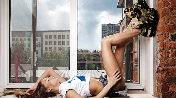 lying on back, closed eyes, girl, jean shorts, flat belly, legs up, window, shoes