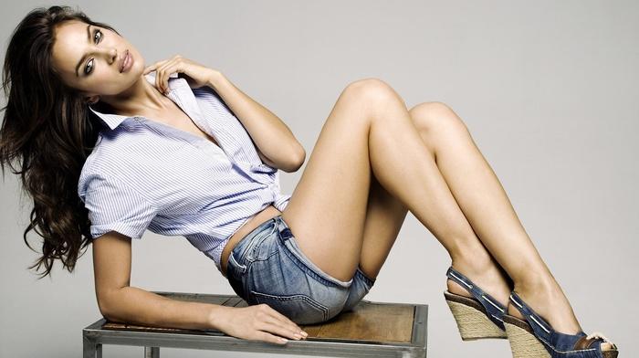 jeans, blouses, blue eyes, open mouth, brunette, eyeliner, table, hot pants, bent legs, sitting, juicy lips, Irina Shayk, short shorts