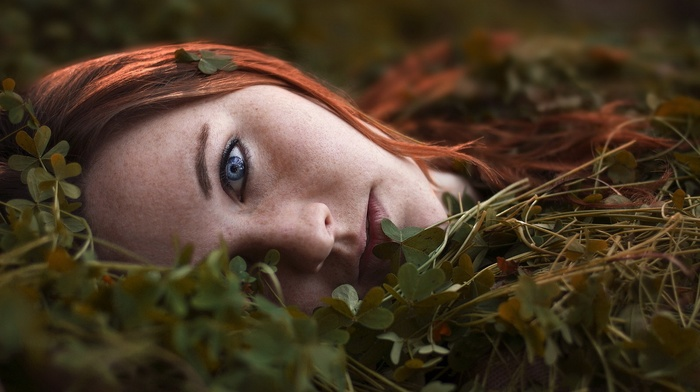 nature, girl outdoors, plants, blue eyes, looking at viewer, face, girl, lying on side, redhead, field, depth of field, model, clovers, freckles, long hair