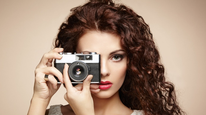 tank top, makeup, simple background, girl, Lorde, camera, long hair, open mouth, brunette, red lipstick, curly hair, model, hand, portrait, looking at viewer, face
