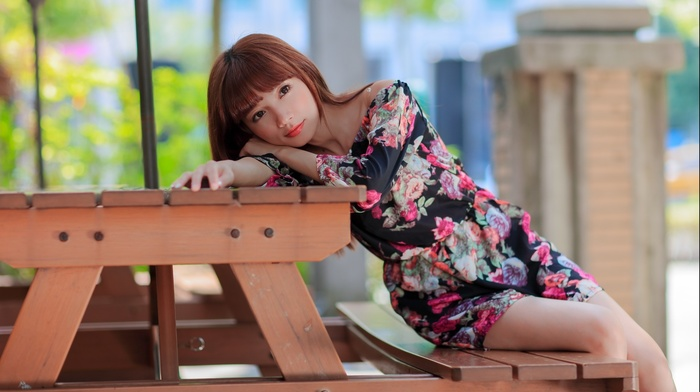 red lipstick, brunette, bench, long hair, looking at viewer, sitting, table, girl outdoors, flowers, wood, Asian, brown eyes, model, girl