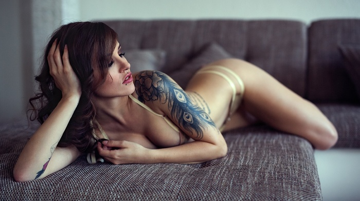 pierced lip, piercing, closed eyes, white lingerie, lying down, smoky eyes, girl, brunette, lingerie, boobs, tattoo
