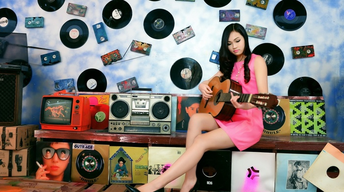 girl, radio, pink dress, guitar, stiletto, brunette, looking down, vinyl, music, cassette, high heels, sitting, speakers, long hair, television sets, walls, model, Asian, playing
