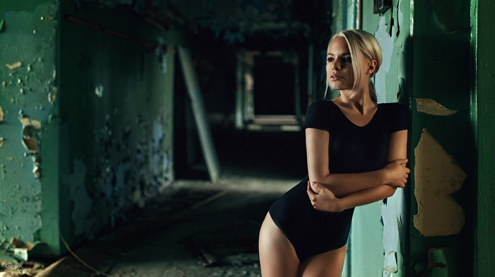 legs together, blonde, tight clothing, ruins, walls, bodysuit, sporty, girl, long hair, standing, hallway, model, abandoned, black clothing, looking away, Georgiy Chernyadyev, open mouth