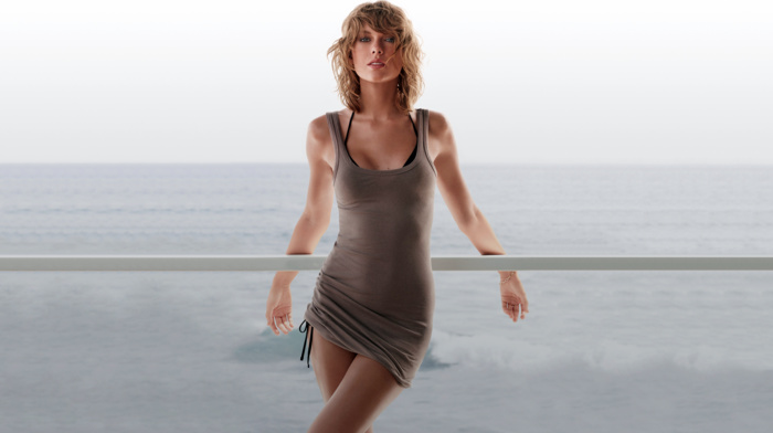 legs, long hair, open mouth, Taylor Swift, face, singer, looking at viewer, water, blonde, horizon, musicians, hair in face, sea, legs  crossed, bare shoulders, wavy hair, girl outdoors, girl, waves