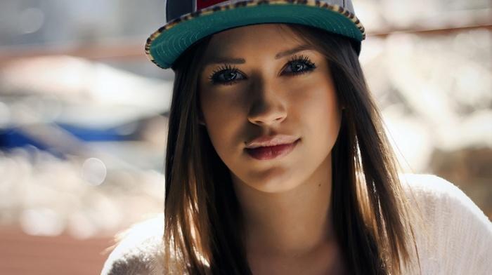 face, blue eyes, Tiffany Thompson, brunette, baseball caps, girl, depth of field, looking at viewer, kohl eyes, juicy lips
