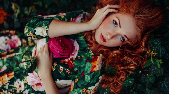looking at viewer, redhead, flowers, girl outdoors, curly hair, freckles, nature, leaves, long hair, rose, model, girl, blue eyes