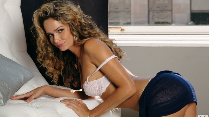 blonde, looking at viewer, miniskirt, cleavage, white bra, long hair, arched back, girl, kneeling, white lingerie, curly hair, smiling, Prinzzess, Playboy, Felicity Jade, model, couch, ass
