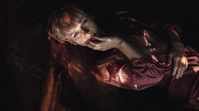 finger on lips, Josephine Binder, lying on back, redhead, long hair, sunlight, dress, freckles, dark, looking at viewer, blue eyes, open mouth, girl, model