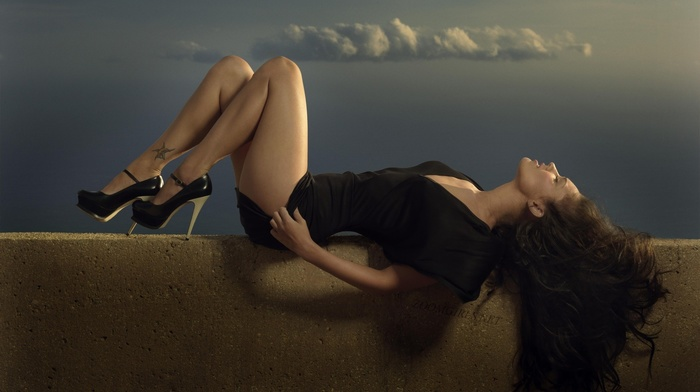 tattoo, brunette, lying down, girl, celebrity, closed eyes, long hair, black dress, thighs, legs, high heels, clouds, actress, Megan Fox, open mouth, walls
