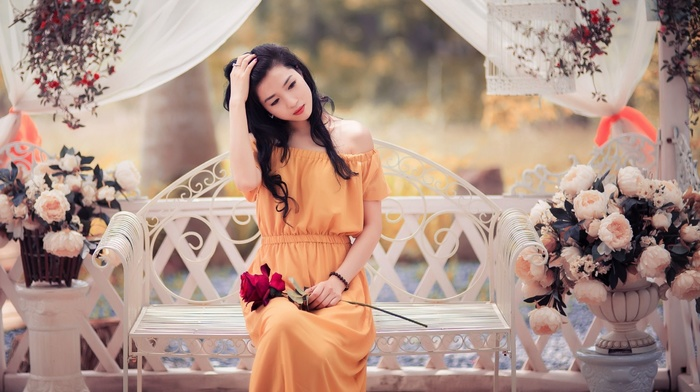 flowers, orange dress, nature, sitting, bench, brunette, rose, trees, model, Asian, girl, girl outdoors, hands in hair, long hair, curtain, red lipstick, looking down