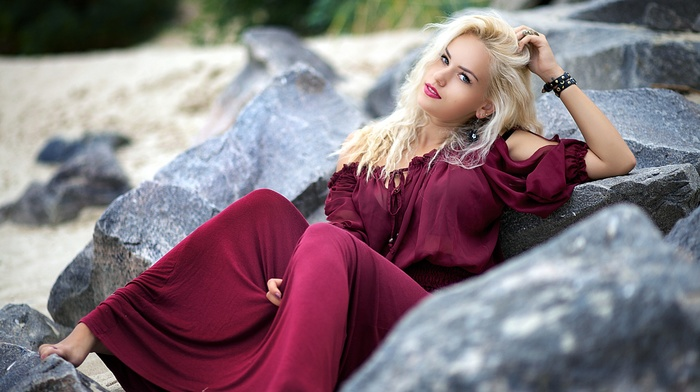 looking at viewer, girl, barefoot, rock, hands in hair, nature, depth of field, open mouth, purple dresses, girl outdoors, hands on head, model, blue eyes, long hair, blonde, bare shoulders