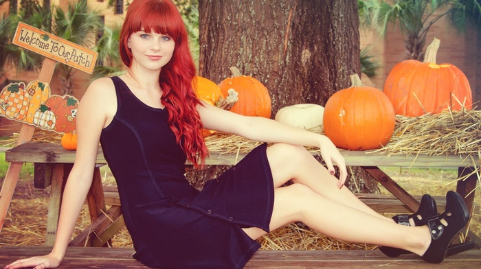 nature, smiling, wooden surface, girl outdoors, trees, looking at viewer, table, hay, redhead, Karoline Kate, model, blue eyes, long hair, bangs, bare shoulders, black dress, sitting, girl, high heels, pumpkin
