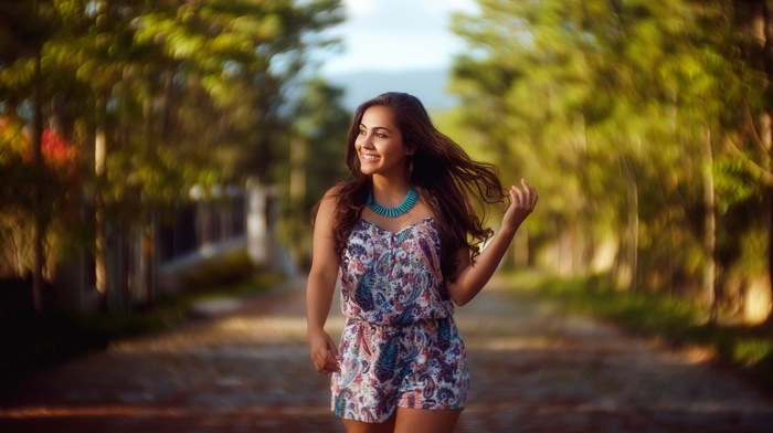 looking away, street, bare shoulders, necklace, walking, brunette, blurred, smiling, model, long hair, girl, nature, brown eyes, depth of field, tank top, shorts, girl outdoors, trees