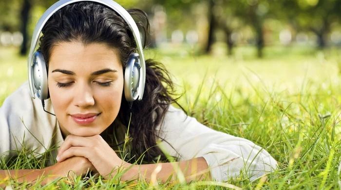 long hair, brunette, trees, girl outdoors, closed eyes, face, depth of field, grass, smiling, nature, girl, headphones, model, portrait, lying on front
