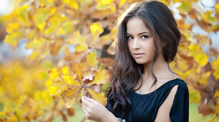 girl outdoors, brunette, leaves, face, necklace, girl, nature, long hair, black dress, open mouth, depth of field, trees, fall, model, looking at viewer, portrait, brown eyes