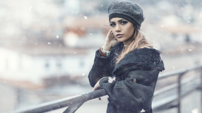 coats, winter, snow flakes, fence, hat, girl, depth of field, long hair, model, looking at viewer, girl outdoors, windy, blonde