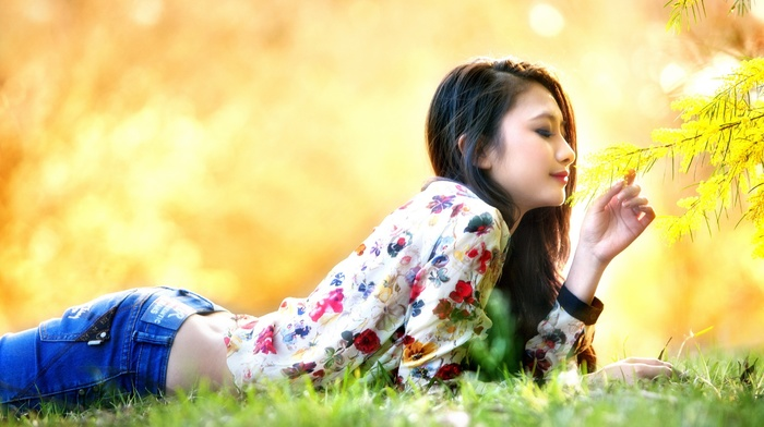 fall, blouses, jeans, smiling, girl outdoors, Korean, face, nature, flowers, depth of field, lying on front, trees, model, brunette, long hair, girl, looking down, park, Asian, grass