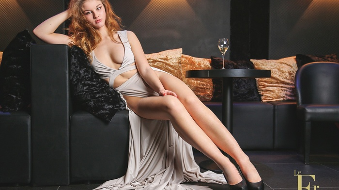 high heels, cleavage, portrait, couch, dress, hands on head, blonde, sensual gaze, girl, strategic covering, sitting