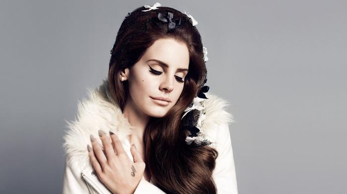 singer, simple background, girl, Lana Del Rey, brunette, eyeliner, celebrity, hands on chest, closed eyes