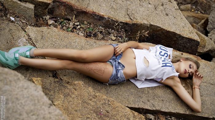 girl outdoors, Ilona Kuznetsova, model, tattoo, Dmitriy Tikunov, closed eyes, portrait, armpits, T, shirt, rock, jean shorts, sneakers, open shorts, girl, blonde