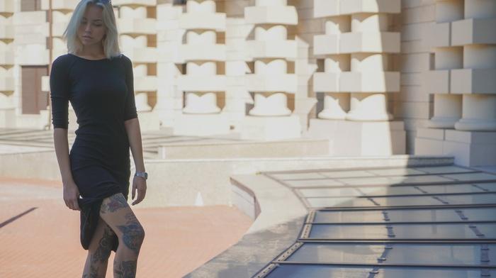 legs, girl outdoors, tattoo, skirt, black dress, sunglasses, girl with glasses, urban, blonde, shadow, girl, building, long hair, sunlight, model