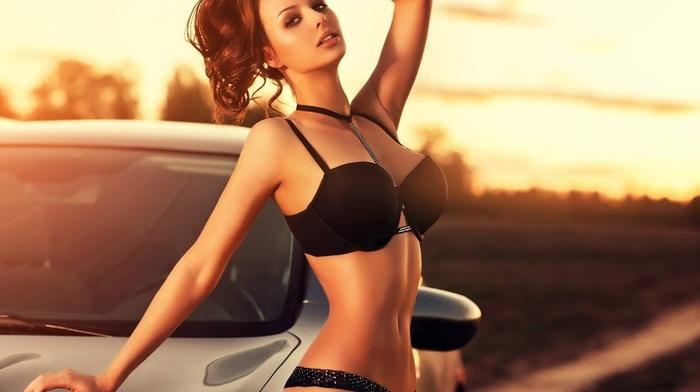 model, girl outdoors, sunset, black lingerie, hands on head, girl with cars, girl