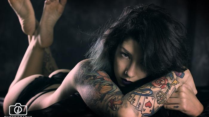 girl, tattoo, ass, lying on front, topless, black hair, blue eyes, feet, black panties, brunette, thong, pierced nose