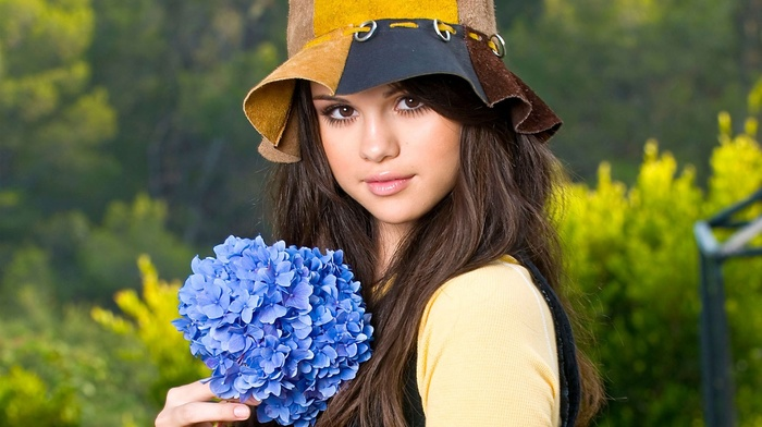 Selena Gomez, brunette, girl outdoors, actress, millinery, girl, flowers, brown eyes, looking at viewer, celebrity, singer, long hair