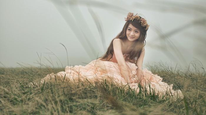 girl outdoors, Asian, long hair, brunette, girl, model, sitting, smiling, wreaths, looking away
