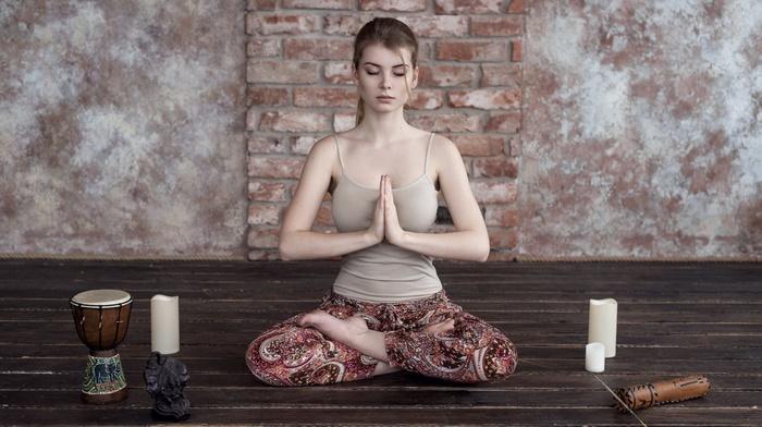 yoga, legs crossed, pale, candles, Irina Popova, tank top, girl, drums, big boobs, on the floor, meditation, wall, bricks, wooden surface, closed eyes, Maxim Guselnikov, sitting, brunette