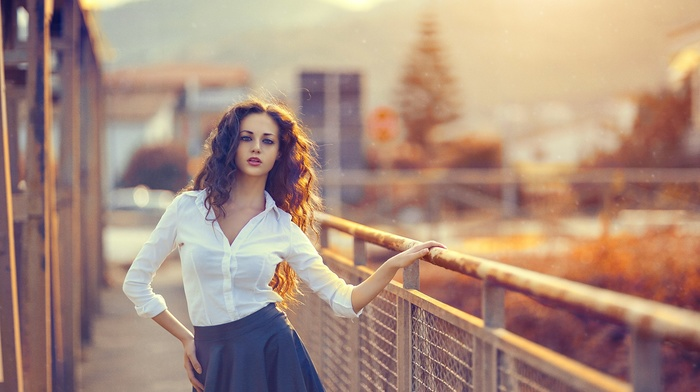 brunette, long hair, white shirt, blue skirt, open mouth, urban, girl outdoors, model, girl, looking at viewer, fence, hands on hips