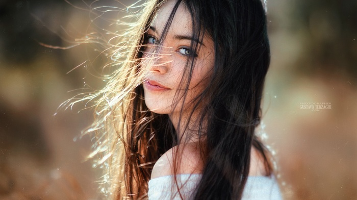bare shoulders, long hair, hair in face, girl outdoors, brunette, depth of field, eyes, face, girl, looking at viewer, model, sweater, Gustavo Terzaghi