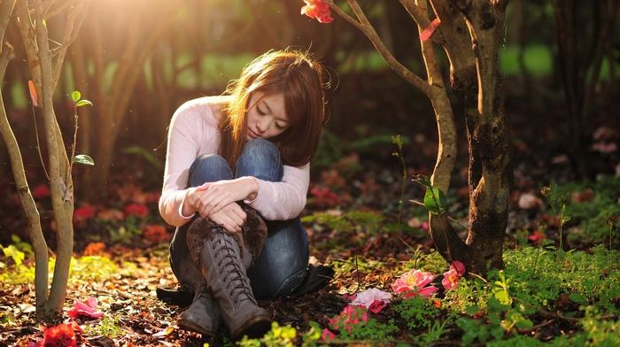 closed eyes, brunette, sitting, sunlight, long hair, depth of field, model, jeans, girl, girl outdoors, trees, nature, white tops, flowers, grass, plants, Asian, leaves, boots