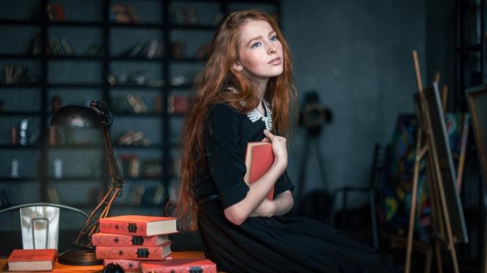 looking away, table, freckles, sitting, redhead, girl, long hair, wavy hair, blue eyes, black dress