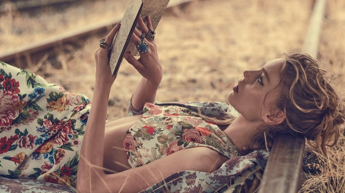 lying on back, railway, profile, map, girl outdoors, depth of field, floral, books, blonde, reading, rings, long hair, girl, nature, grass, model