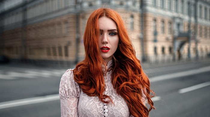 building, model, Georgy Chernyadyev, red lipstick, white clothing, girl outdoors, hair in face, blue eyes, open mouth, wavy hair, girl, redhead, long hair, windy, urban, looking at viewer, street